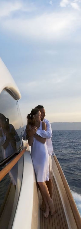 Couple Standing on starboard side on Mochi Yacht